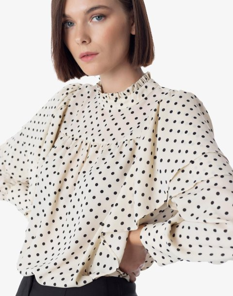 Polka dot top with ruffles