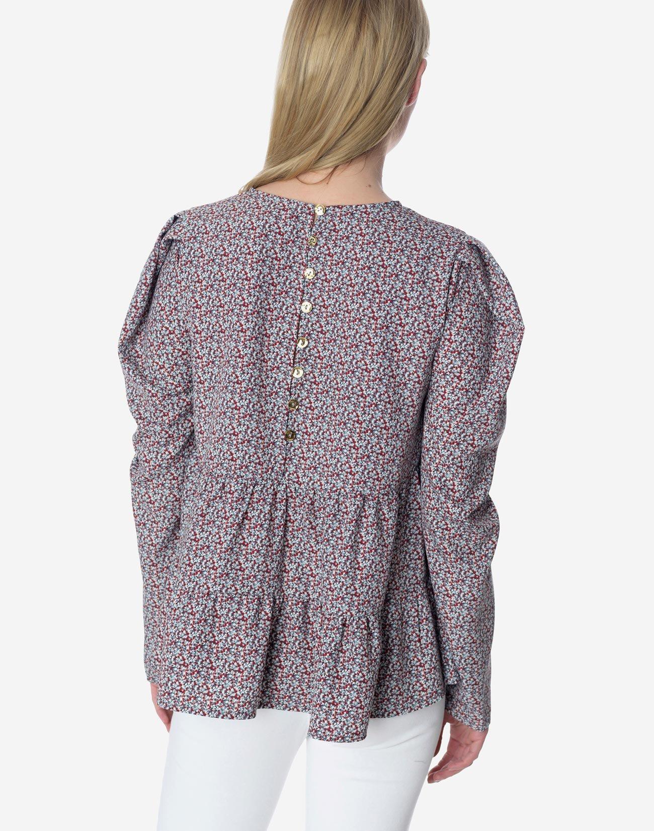 Εμπριμέ μπλούζα με διπλό βολάν