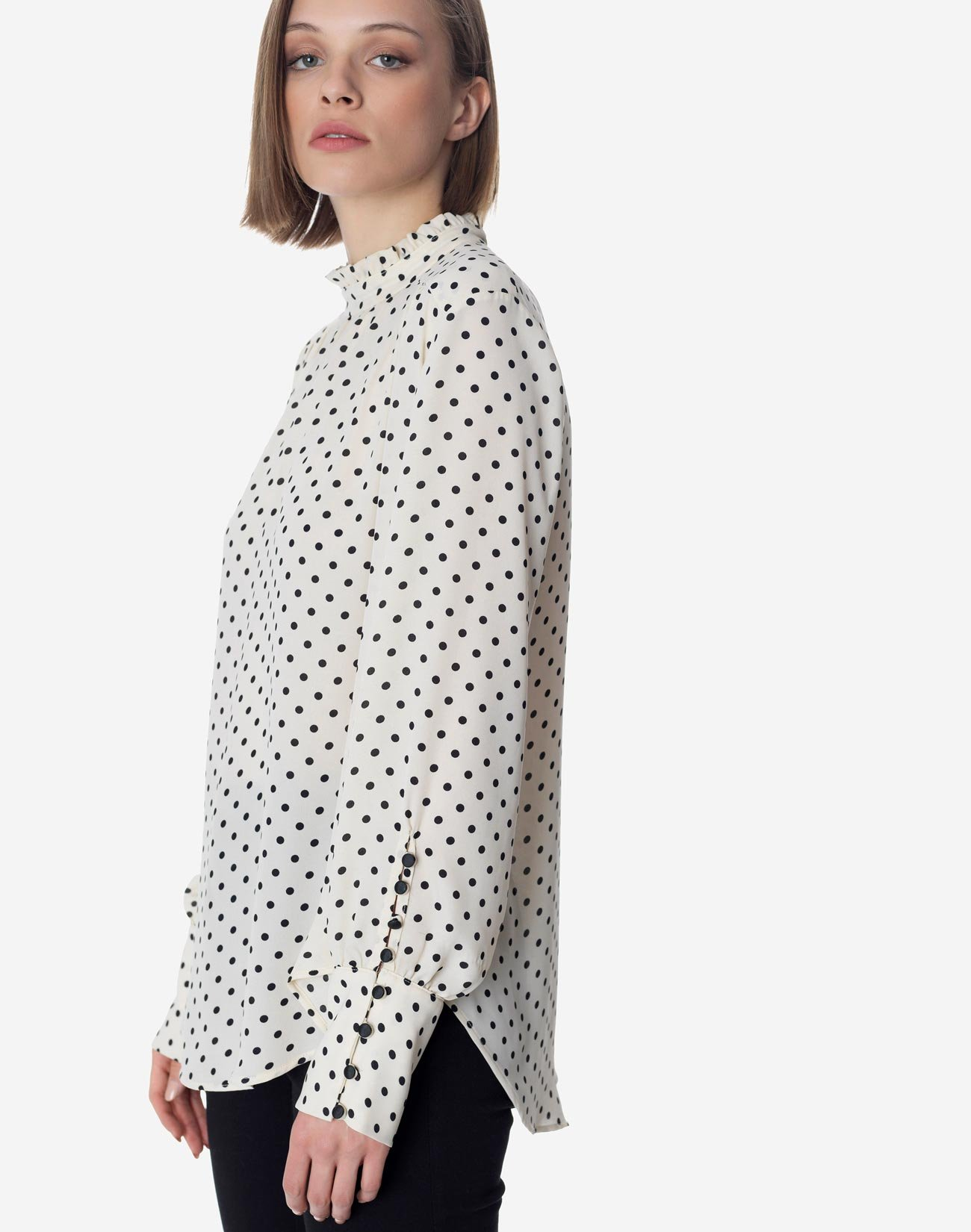 Polka dot blouse with high neck