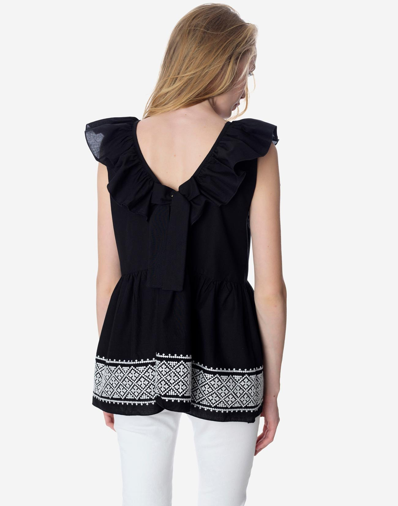 Ruffled top with embroidery