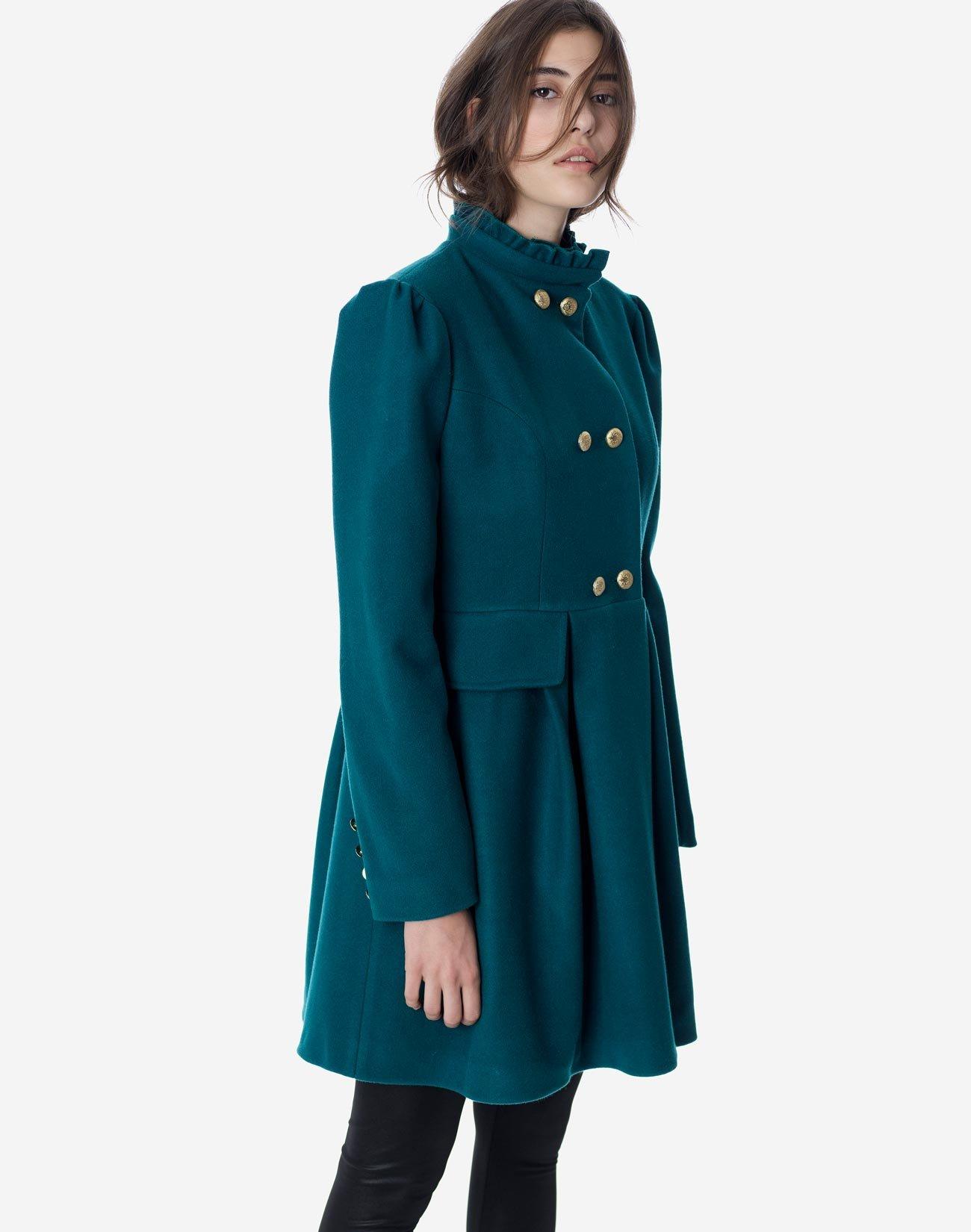 Coat with high ruffle collar