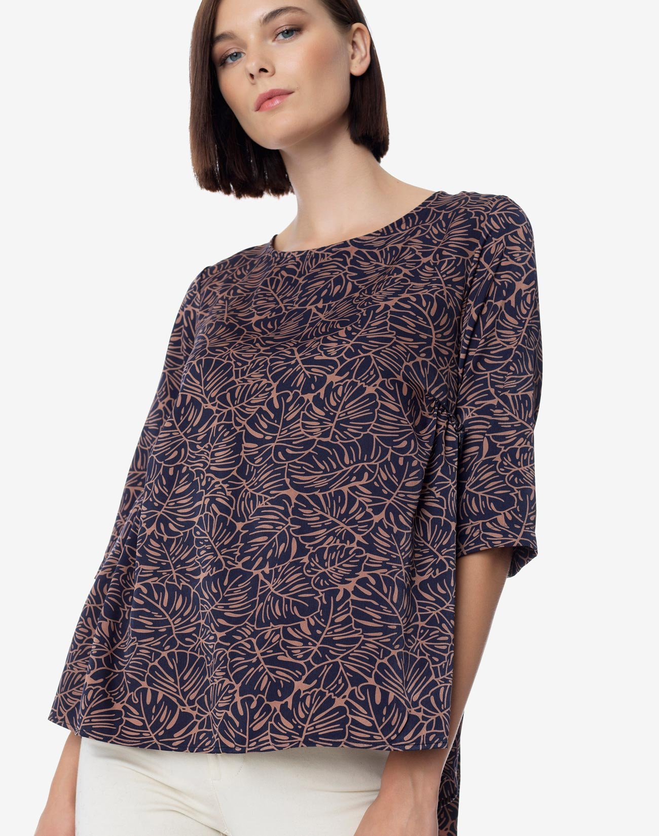 Printed top with pleat and ruffles