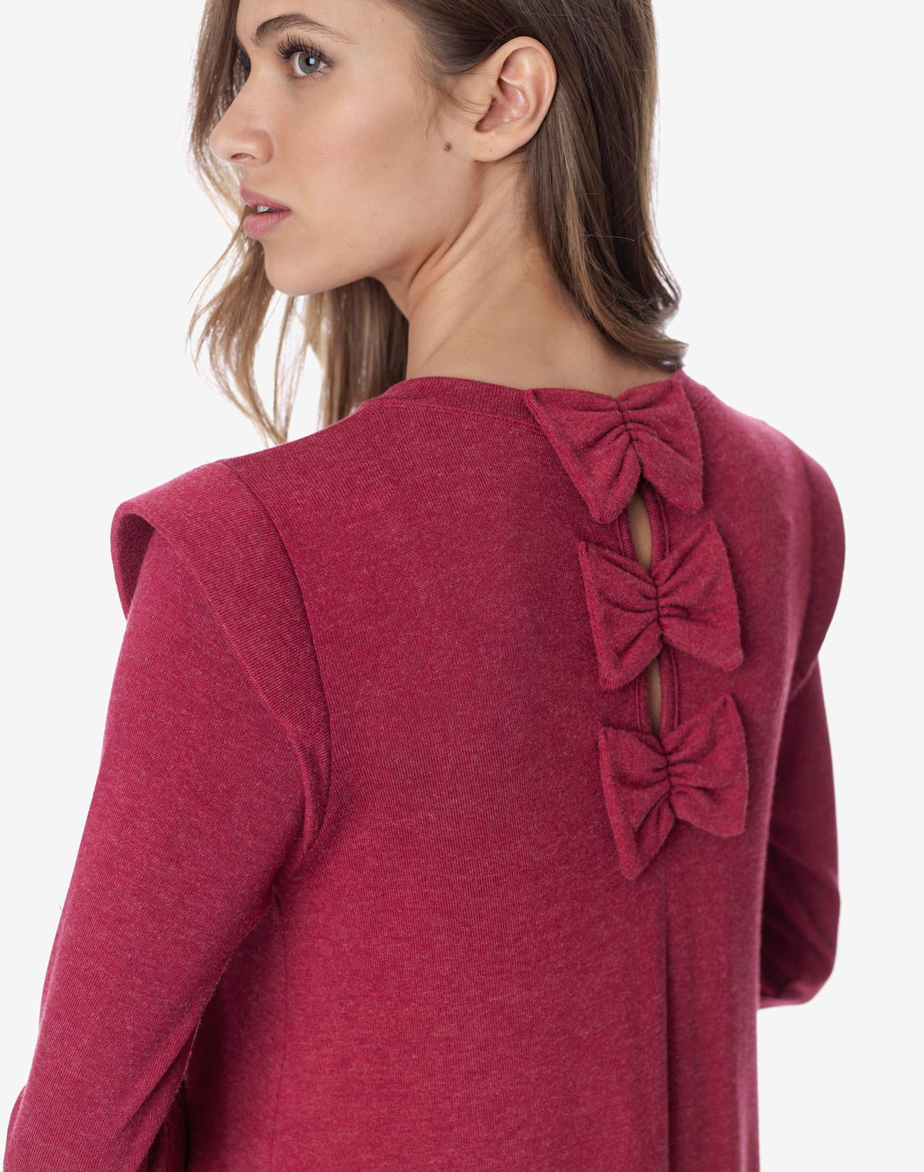 Top with shoulder pads and bows