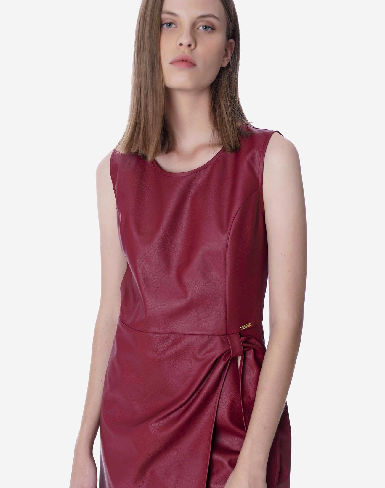Mini faux leather dress with knot detail