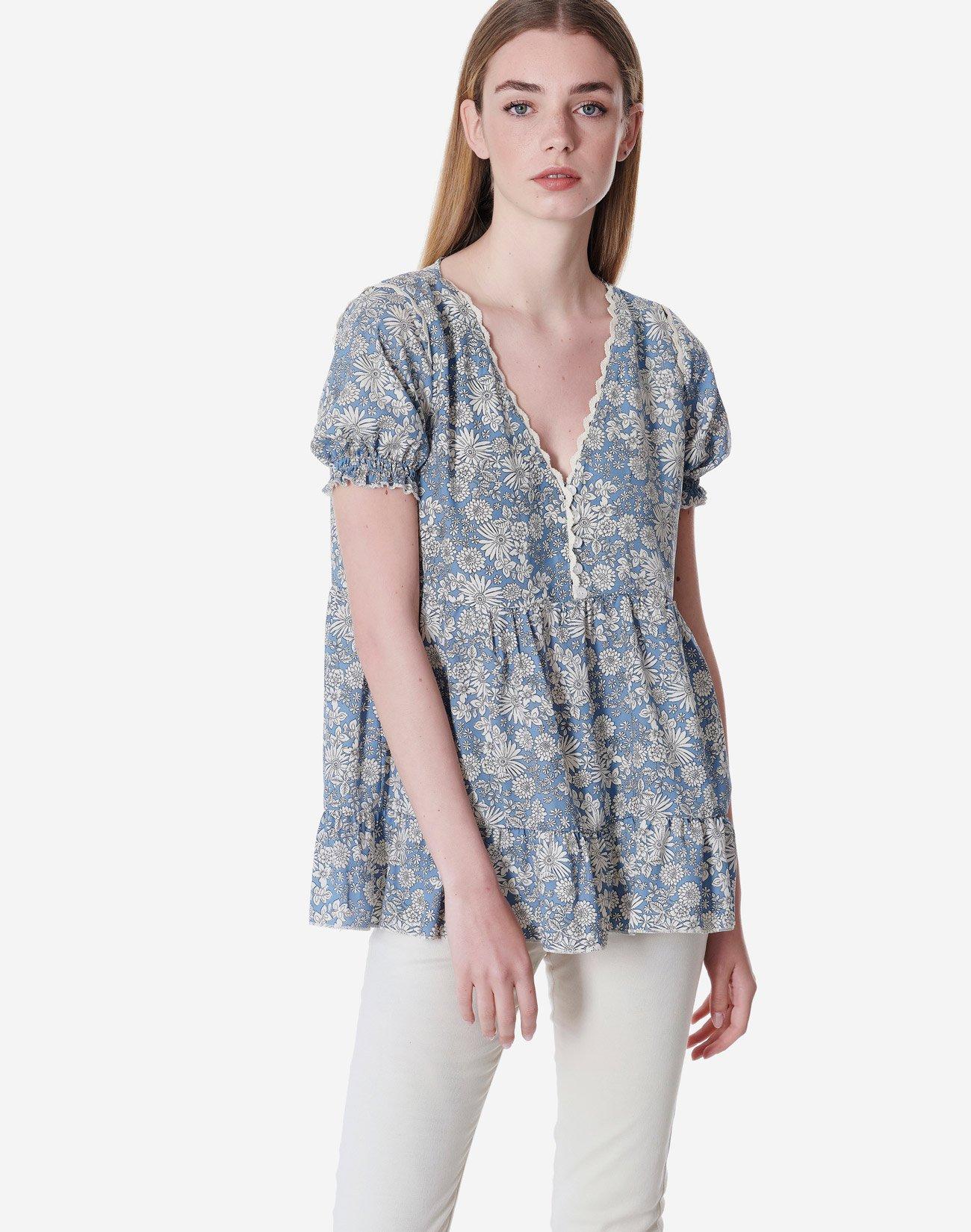 Εμπριμέ μπλούζα με κουμπιά