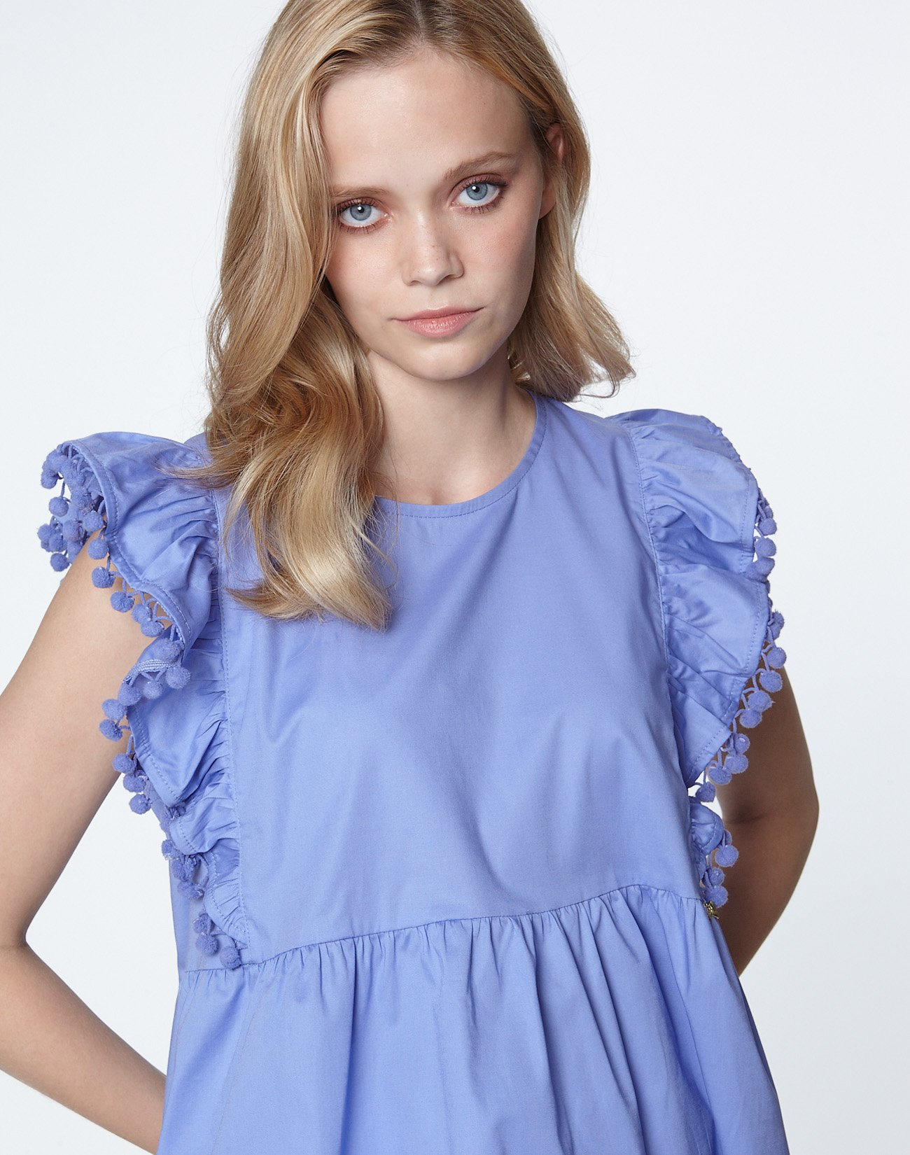 Top with ruffles and pom poms