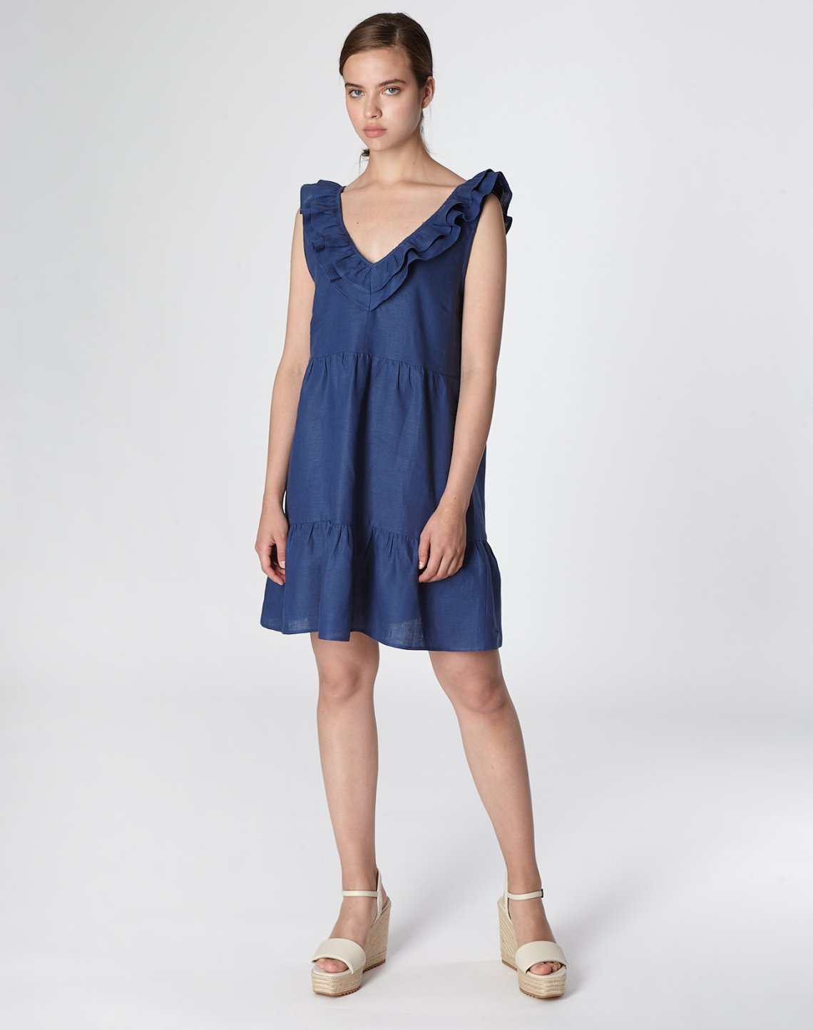 Mini linen dress with ruffles and bow